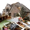 Damage to a home in the Oak Tree housing addition on Wednesday, Feb. 11, 2009, after a tornado hit the area on Tuesday in Edmond, Okla. PHOTO BY CHRIS LANDSBERGER, THE OKLAHOMAN