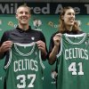 Photo - Boston Celtics 2013 NBA basketball draft picks Colton Iverson, left, and Kelly Olynyk, right, display their jerseys during a news conference held to introduce the players in Boston, Monday, July 1, 2013. (AP Photo/Steven Senne)