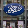 People walk past the Boots flagship store, owned by Swiss health and beauty retailer Alliance Boots, on Oxford Street in London, Wednesday, Aug. 6, 2014. Walgreen plans to keep its roots firmly planted in the United States, saying it will no longer pursue an overseas reorganization that would have trimmed the amount of U.S. taxes it pays. The nation\'s largest drugstore chain said that, as previously planned, it will buy the remaining stake in Alliance Boots that it does not already own. It will not pull off an inversion, however, a tactic that has become increasingly popular with U.S. companies seeking tax relief, but which has sparked a backlash in Washington and among the public. (AP Photo/Matt Dunham)