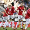 Manchester United\'s Jonny Evans, second right, celebrates his goal with his teammates during their English Premier League soccer match against Newcastle United at the Sports Direct Arena, Newcastle, England, Sunday, Oct. 7, 2012. (AP Photo/Scott Heppell)