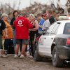 Emergency personnel talk with people outside Plaza Towers Elementary School in Moore, Okla., after a tornado damaged the area on Monday, May 20, 2013. Photo by Bryan Terry, The Oklahoman