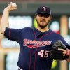 Photo - Minnesota Twins pitcher Phil Hughes throws against the San Diego Padres in the first inning of a baseball game, Tuesday, Aug. 5, 2014, in Minneapolis. (AP Photo/Jim Mone)