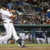 Photo - Boston Red Sox Will Middlebrooks hits an RBI double to bring in the go-ahead run in the seventh inning of an exhibition baseball game against the Minnesota Twins in Fort Myers, Fla., Thursday, March 27, The Red Sox won 4-1.2014. (AP Photo/Gerald Herbert)