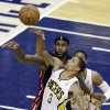 Indiana Pacers\' George Hill (3) is defended by Miami Heat\'s LeBron James during the second half of Game 3 of the NBA Eastern Conference basketball finals in Indianapolis, Sunday, May 26, 2013. (AP Photo/Michael Conroy)