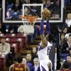 Sacramento Kings forward Thomas Robinson, center, dunks between Cleveland Cavaliers\' Dion Waiters, left, and Kyrie Irving during the first quarter of an NBA basketball game in Sacramento, Calif., Monday, Jan. 14, 2013. (AP Photo/Rich Pedroncelli)