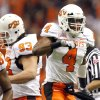 Oklahoma State\'s Justin Gilbert (4) celebrates a fumble recovery during the Valero Alamo Bowl college football game between the Oklahoma State University Cowboys (OSU) and the University of Arizona Wildcats at the Alamodome in San Antonio, Texas, Wednesday, December 29, 2010. Photo by Sarah Phipps, The Oklahoman