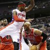 Photo - Detroit Pistons forward Josh Smith (6) falls towards Chicago Bulls forward Taj Gibson (22) during the first half of an NBA basketball game in Auburn Hills, Mich., Wednesday, March 5, 2014. (AP Photo/Carlos Osorio)