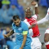 Photo - Zenit's Danny fights for the ball with Standard's de Liege Paul-Jose Mpoku during the UEFA Champions League, play offs, 2nd leg, soccer match, between Standard de Liege  and Zenit St. Petersburg in St.Petersburg, Russia, Tuesday, Aug. 26, 2014. (AP Photo/Dmitry Lovetsky)