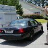 Photo - A police car pulls into the parking lot of Alzheimer's Care of Commerce, Ga., Tuesday, July 2, 2013 after officials executed an early morning search warrant on the facility. The GBI announced that 21 people at the facility were being charged with abusing residents there. (AP Photo/The Atlanta Journal-Constitution, Ben Gray)