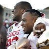 Gerald McCoy, defensive lineman of the game, and Ryan Broyles, player of the game hold a collection of trophys after their 31-27 victory at the Brut Sun Bowl college football game between the University of Oklahoma Sooners (OU) and the Stanford University Cardinal on Thursday, Dec. 31, 2009, in El Paso, Tex. Photo by Steve Sisney, The Oklahoman