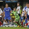Photo - Fulham's goalkeeper David Stockdale, in green centre, watches as the ball goes past defenders and Chelsea's strikers during the English Premier League soccer match between Chelsea and Fulham at Stamford Bridge, London, Saturday, Sept. 21, 2013. (AP Photo/Sang Tan)