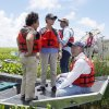 FILE - In this Thursday, Aug. 19, 2010 file photo, White House Council on Environmental Quality chair Nancy Sutley, left, NOAA Administrator Jane Lubchenco, EPA Administrator Lisa Jackson and Interior Secretary Ken Salazar look out at wetlands from an air boat during a tour of the Delta National Wildlife Refuge on the coast of Louisiana. The tour was held to show areas of opportunity for wetlands restoration and growth along the Louisiana coast after the Deepwater Horizon oil spill. The head of the National Oceanic and Atmospheric Administration said Wednesday, Dec. 12, 2012 she will leave her post at the end of February 2013. (AP Photo/Patrick Semansky)