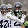 Photo - Seattle Seahawks' Chris Maragos (42) and Richard Sherman run through a drill at an NFL football practice Thursday, Jan. 16, 2014, in Renton, Wash. The Seahawks are to play the San Francisco 49ers on Sunday in the NFC championship game. (AP Photo/Elaine Thompson)