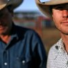 Professional bull rider Justin McBride (right) poses with his father on his ranch south of Elk City, Oklahoma on Feb. 4, 2008. By John Clanton, The Oklahoman