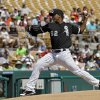 Photo - Chicago White Sox starting pitcher Jose Quintana delivers against the Oakland Athletics in the first inning of a spring exhibition baseball game Tuesday, March 18, 2014, in Glendale, Ariz. (AP Photo/Mark Duncan)