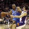 Photo - Oklahoma City Thunder guard Russell Westbrook, left, is fouled by Phoenix Suns guard Steve Nash in the first quarter of an NBA basketball game Friday, Feb 20, 2009, in Phoenix. (AP Photo/Paul Connors) ORG XMIT: PNU101