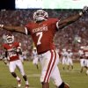 OU\'s DeMarco Murray celebrates after a touchdown during the second half of the college football game between the University of Oklahoma Sooners (OU) and Utah State University Aggies (USU) at the Gaylord Family-Oklahoma Memorial Stadium on Saturday, Sept. 4, 2010, in Norman, Okla. Photo by Bryan Terry, The Oklahoman