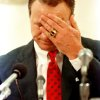 In this June 20, 1989 file photo, University of Oklahoma football coach Barry Switzer wipes his face during an emotional moment at a news conference where he announced his resignation in Norman, Okla. Twenty years later, Switzer says he no longer dwells on his tearful resignation as Oklahoma\'s football coach. The school had been hit by NCAA probation and player arrests. The resignation led to the Sooners\' decade-long exile from college football\'s elite. (AP Photo/David Longstreath, File)