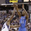 Photo - Oklahoma City Thunder forward Kevin Durant, right, passes over Sacramento Kings forward Travis Outlaw during the first quarter of an NBA basketball game, Tuesday, April 8, 2014, in Sacramento, Calif. (AP Photo/Rich Pedroncelli)