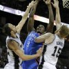 Oklahoma City\'s Serge Ibaka (9) gets caught between San Antonio\'s Tim Duncan (21) and Matt Bonner (15) during Game 2 of the Western Conference Finals between the Oklahoma City Thunder and the San Antonio Spurs in the NBA playoffs at the AT&T Center in San Antonio, Texas, Tuesday, May 29, 2012. Photo by Bryan Terry, The Oklahoman