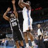 Oklahoma City\'s James Harden (13) takes a shot against San Antonio\'s James Anderson (25) during the NBA basketball game between the Oklahoma City Thunder and the San Antonio Spurs at Chesapeake Energy Arena in Oklahoma City, Friday, March 16, 2012. Photo by Nate Billings, The Oklahoman
