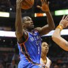 Photo - Oklahoma Thunder forward Serge Ibaka, of Congo, shoots against the Phoenix Suns during the first half of an NBA preseason basketball game, Tuesday, Oct. 22, 2013, in Phoenix. (AP Photo/Matt York)