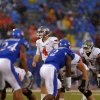 Oklahoma State\'s J.W. Walsh (4) stands behind the line of scrimmage during the college football game between Oklahoma State University (OSU) and the University of Kansas (KU) at Memorial Stadium in Lawrence, Kan., Saturday, Oct. 13, 2012. Photo by Sarah Phipps, The Oklahoman