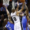 San Antonio\'s Tony Parker (9) goes to the basket between Oklahoma City\'s Caron Butler (2) and Perry Jones (3) during Game 2 of the Western Conference Finals in the NBA playoffs between the Oklahoma City Thunder and the San Antonio Spurs at the AT&T Center in San Antonio, Wednesday, May 21, 2014. Photo by Sarah Phipps, The Oklahoman