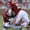 Oklahoma\'s Tony Jefferson (1) and R.J. Washington (11) bring down Florida A&M\'s Eddie Rocker (9) during the college football game between the University of Oklahoma Sooners (OU) and Florida A&M Rattlers at Gaylord Family-Oklahoma Memorial Stadium in Norman, Okla., Saturday, Sept. 8, 2012. Photo by Bryan Terry, The Oklahoman