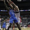 Photo - Oklahoma City Thunder guard Reggie Jackson (15) shoots over Washington Wizards center Marcin Gortat (4), from Poland, in the first half of an NBA basketball game on Saturday, Feb. 1, 2014, in Washington. (AP Photo/Alex Brandon)
