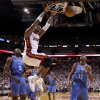 Miami\'s Chris Bosh (1) dunks the ball as Oklahoma City\'s Kendrick Perkins (5) and Oklahoma City\'s Kevin Durant watch during Game 3 of the NBA Finals between the Oklahoma City Thunder and the Miami Heat at American Airlines Arena, Sunday, June 17, 2012. Photo by Bryan Terry, The Oklahoman