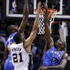 Oklahoma City\'s Serge Ibaka (9) and Kendrick Perkins (5) defend against San Antonio\'s Tim Duncan (21) during Game 5 of the Western Conference Finals in the NBA playoffs between the Oklahoma City Thunder and the San Antonio Spurs at the AT&T Center in San Antonio, Thursday, May 29, 2014. Photo by Sarah Phipps, The Oklahoman