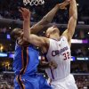 Oklahoma City\'s Serge Ibaka (9) fouls Los Angeles\' Blake Griffin (32) in the fourth quarter during Game 4 of the Western Conference semifinals in the NBA playoffs between the Oklahoma City Thunder and the Los Angeles Clippers at the Staples Center in Los Angeles, Sunday, May 11, 2014. Photo by Nate Billings, The Oklahoman