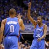 Oklahoma City\'s Kevin Durant (35) and Russell Westbrook (0) celebrate after a basket during Game 3 of the first round in the NBA playoffs between the Oklahoma City Thunder and the Dallas Mavericks at American Airlines Center in Dallas, Thursday, May 3, 2012. Photo by Bryan Terry, The Oklahoman