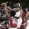 Photo - South Carolina's Elem Ibiam (33) drives for the basket as Alabama's Ashley Williams (3) tries to block during the first half of their NCAA college basketball game, Sunday, Jan. 19, 2014, in Columbia, SC. (AP Photo/Mary Ann Chastain)