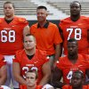 OSU head football coach Mike Gundy poses with the team\'s seniors during media day for the OSU football team at Gallagher-Iba Arena in Stillwater, Okla., Saturday, Aug. 4, 2012. Photo by Nate Billings, The Oklahoman