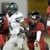 Norman North\'s Z\'Quan Hogan gets by Del City\'s Brandon McFadden during the high school football game between Norman North and Del City at Del City, Okla., Friday, Sept. 13, 2013. Photo by Sarah Phipps, The Oklahoman