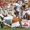 Photo - University of Oklahoma quarterback  Sam  Bradford (14) is sacked by Texas' Aaron Williams in the first half of an NCAA college football game, Saturday, Oct. 17, 2009, in Dallas.  Bradford was injured on the play. (AP Photo/Donna McWilliam)