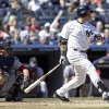 Photo - New York Yankees' Carlos Beltran follows through with a double during the sixth inning of a baseball game as Boston Red Sox catcher A.J. Pierzynski watches the ball hit by Beltran, Saturday, April 12, 2014, in New York. (AP Photo/Frank Franklin II)
