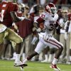 Oklahoma\'s Javon Harris (30) runs past Florida\'s EJ Manuel (3) after an interception during a college football game between the University of Oklahoma (OU) and Florida State (FSU) at Doak Campbell Stadium in Tallahassee, Fla., Saturday, Sept. 17, 2011. Photo by Bryan Terry, The Oklahoman