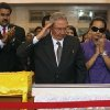 Photo - In this photo released by Miraflores Press Office,  Cuba's President Raul Castro salutes as he stands next to the coffin containing the remains of  Venezuela's late President Hugo Chavez during his wake at a military academy where his body will lie in state until his funeral in in state in Caracas, Venezuela, Thursday, March 7, 2013.  Nicolas Maduro, Venezuela's acting president, said Chavez's  remains will be put on permanent display at the Museum of the Revolution, close to the presidential palace where Chavez ruled for 14 years. A state funeral for Chavez attended by some 33 heads of government is scheduled to begin Friday morning.  At right is Chavez's daughter Rosa Virginia Chavez and left is Vice-President Nicolas Maduro.(AP Photo/Miraflores Press Office)