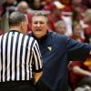 Photo - West Virginia coach Bob Huggins argues with an official, shortly before being assessed a technical foul during the first half of an NCAA college basketball game against Iowa State in Ames, Iowa, Wednesday, Feb. 26, 2014. (AP Photo/Justin Hayworth)