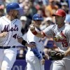 New York Mets\' John Buck, left, is tagged out by St. Louis Cardinals third baseman Matt Carpenter after being caught between third and home during the fourth inning of an exhibition spring training baseball game, Friday, March 29, 2013, in Port St. Lucie, Fla. (AP Photo/Jeff Roberson)