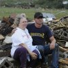 Judy Cook who lost her Masters Drive home is conforted by Chase Spradlin in Concord, Ala., Wednesday April 27, 2011. What appeared to be a tornado ripped through parts of Concord, Ala., outside llate Wednesday. The damage in the area is extensive with homes and businesses destroyed and people injured. (AP Photo/Birmingham News, Jeff Roberts)