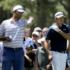 Photo - Jordan Spieth, right, and caddie Michael Greller talk on the 16th tee during a practice round for the U.S. Open golf tournament in Pinehurst, N.C., Tuesday, June 10, 2014. The tournament starts Thursday. (AP Photo/Chuck Burton)