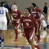 Photo - Alabama's Daisha Simmons (0) celebrates after an NCAA college basketball game against Kentucky, Thursday, Jan. 23, 2014, in Lexington, Ky. Simmons scored 21 points and hit the final shot in Alabama's 57-55 win. (AP Photo/James Crisp)