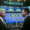 Photo - Atlantic Coast Conference commissioner John Swofford, left, and NASDAQ head of listings Bob McCooey chat before the ringing of the closing bell on Monday, July 1, 2013 in New York.  The ACC visited the NASDAQ Market Site in Times Square to officially announce the addition of its three new members in Notre Dame, Pitt and Syracuse. (AP Photo/Bebeto Matthews)