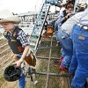 Photo - Bowde 'Shorty Smalls' Sawyer walks the back of the bucking chutes before his bull ride during the Youth Rodeo Bible Camp at the Three Crosses Arena on Wednesday in Union Valley.