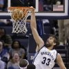 Photo - Memphis Grizzlies' Marc Gasol (33), of Spain, dunks in front of teammate Zach Randolph, left, and Cleveland Cavaliers' Tristan Thompson (13), of Canada, during the first half of an NBA basketball game in Memphis, Tenn., Saturday, March 1, 2014. (AP Photo/Danny Johnston)