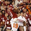 Oklahoma\'s Justin Brown (19) catches a pass against Oklahoma State\'s Brodrick Brown (19) in the fourth quarter during the Bedlam college football game between the University of Oklahoma Sooners (OU) and the Oklahoma State University Cowboys (OSU) at Gaylord Family-Oklahoma Memorial Stadium in Norman, Okla., Saturday, Nov. 24, 2012. OU won, 51-48 in overtime. Photo by Nate Billings , The Oklahoman